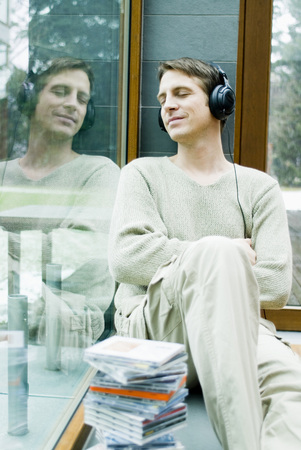full length mirror: Young Man With Headphones Relaxing On Window Sill