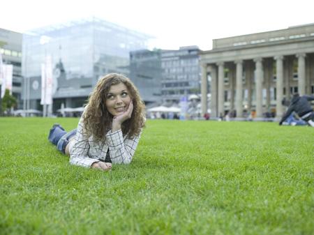 Berlin, Germany, Young Woman Lying In Meadow