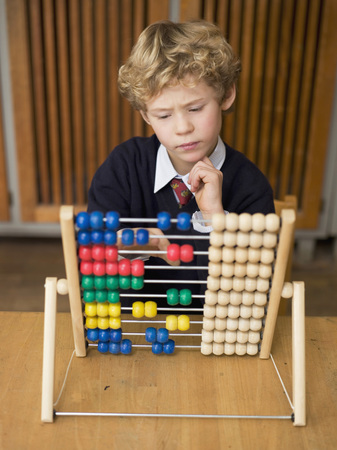 Boy (4-7) Using Abacus, Close-Up