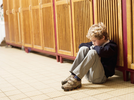 solicitous: Boy (4-7) Sitting In Front Of Locker, Side View