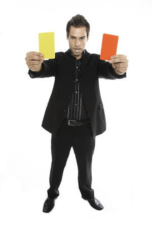 full strenght: Young Man Holding Red And Yellow Card Close-Up