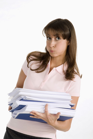 Young Woman Carrying Files, Looking Up, Close-Up