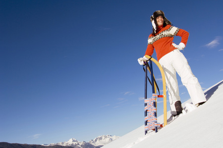Woman In Mountains With Sledge LANG_EVOIMAGES