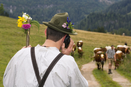 Man Phoning In Mountains, Rear View LANG_EVOIMAGES