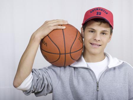 Boy ( 16-17) Holding Basket Ball, Portrait LANG_EVOIMAGES