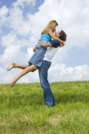 Man Lifting Woman LANG_EVOIMAGES
