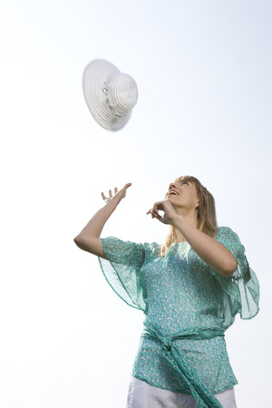 Young Woman Throwing A Hat