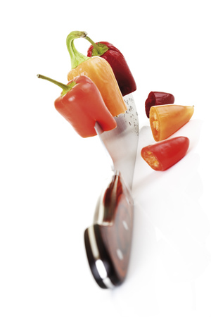 Knife Cutting Through Peppers