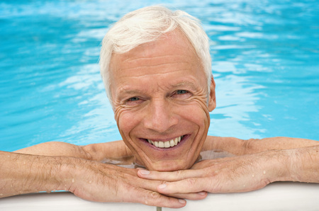 Germany, Senior Man Relaxing In Pool, Close-Up, Portrait LANG_EVOIMAGES