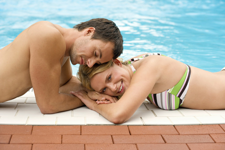 Germany, Young Couple At Swimming Pool, Close-Up LANG_EVOIMAGES