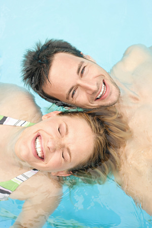 Germany, Couple Relaxing In Swimming Pool, Portrait, Close-Up