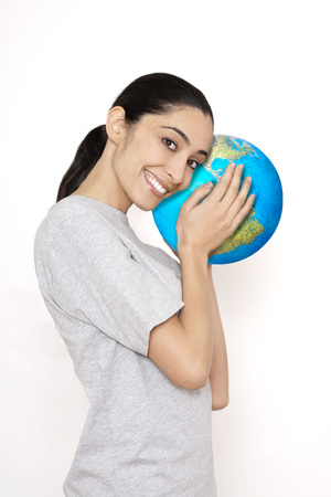 Young Woman Holding Beach Ball, Portrait
