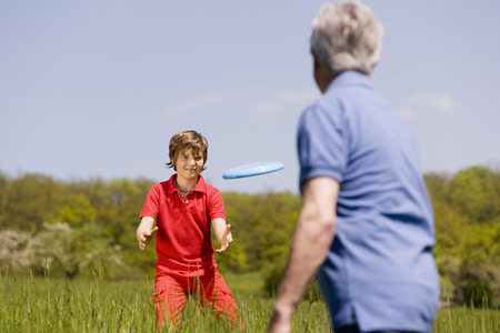 Germany, Baden Wã¼Rttemberg, Tã¼Bingen, Grandfather And Grandson Playing Frisbee LANG_EVOIMAGES