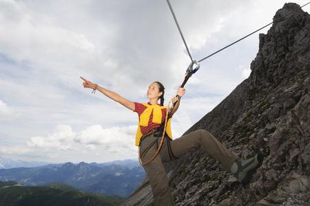 Austria, Salzburger Land, Young Woman Mountain Climbing