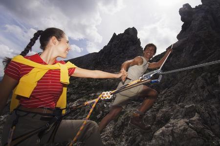 Austria, Salzburger Land, Couple Mountain Climbing LANG_EVOIMAGES