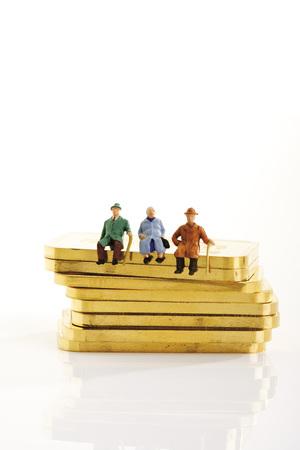 Plastic Figurines Sitting On Gold Bars