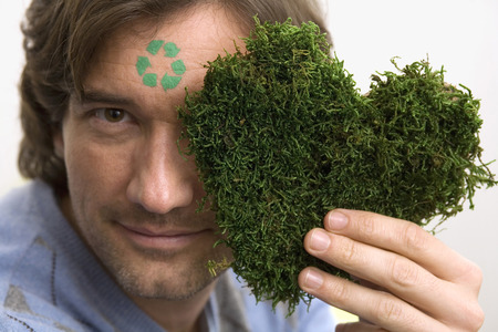 Man With Green Sign On Forehead,Holding Grass Heart, Portrait LANG_EVOIMAGES