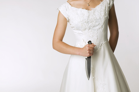 marrying: Bride Holding Knife, Mid Section LANG_EVOIMAGES