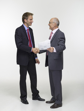 handclasp: Two Businessmen Shaking Hands