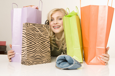Blonde Woman With Shopping Bags, Portrait LANG_EVOIMAGES