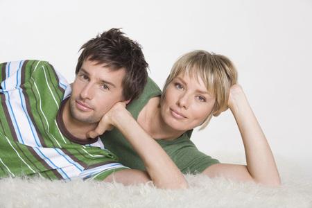 Couple Lying On Carpet, Portrait LANG_EVOIMAGES