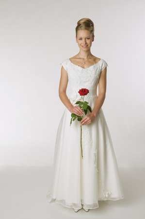 Young Bride Holding A Rose, Smiling, Portrait