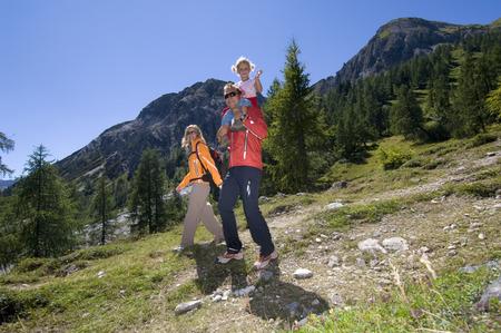 Austria, Salzburger Land, Couple With Daughter (6-7) Hiking