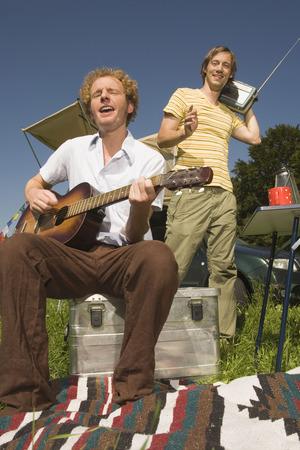 ardor: Germany, Bavaria, Young Man Playing Guitar