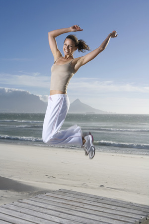 ardor: South Africa, Cape Town, Young Woman Jumping On Beach LANG_EVOIMAGES