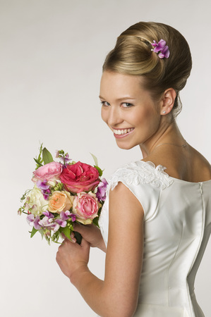 Young Bride Holding Bridal Bouquet