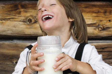 Austria, Salzburger Land,Boy (8-9) Drinking Milk, Laughing, Portrait