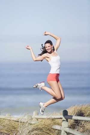 ardor: Young Woman Jumping On Beach