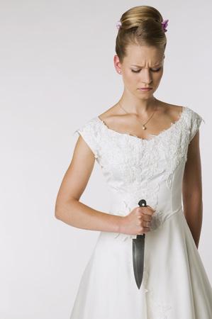 Young Bride Holding Knife, Portrait LANG_EVOIMAGES