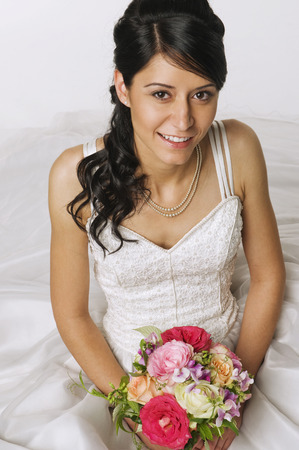 marrying: Young Bride Holding Flowers, Elevated View