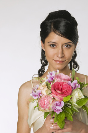 Young Bride Holding Flowers, Close-Up
