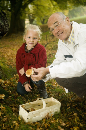 cowering: Germany, Baden-W�Rttemberg, Swabian Mountains, Grandfather And Granddaughter Searching Mushrooms In The Forest, Portrait