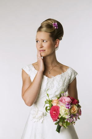 marrying: Young Bride With Bridal Bouquet, Hand To Chin, Portrait LANG_EVOIMAGES