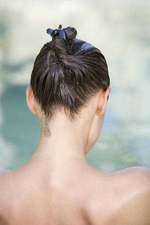 Woman Using Conditioner, Rear View