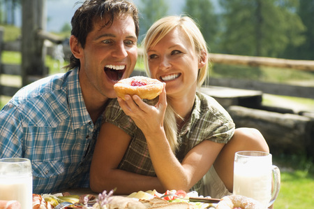 Austria, Salzburger Land, Couple Having Breakfast
