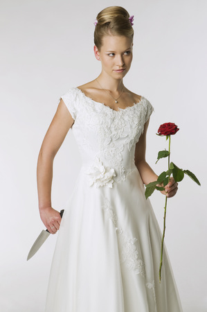 Young Bride Holding Knife And Rose, Portrait