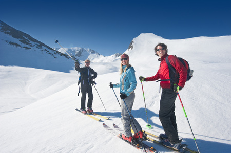 Austria, Salzbzrger Land, Altenmarkt, Zauchensee, Three Persons Cross Country Skiing In Mountains