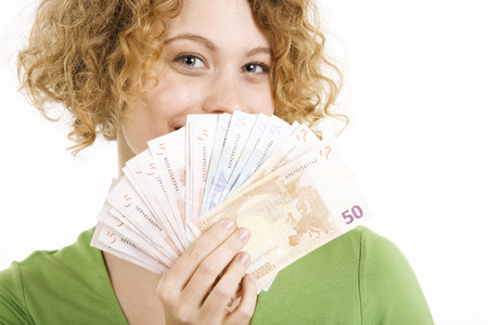 Young Woman Holding Euro Notes, Portrait