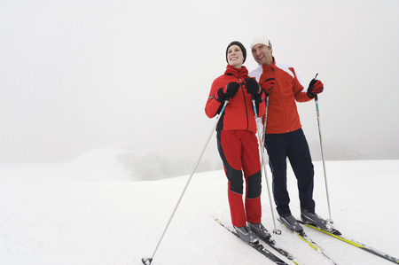 Italy, South Tyrol, Couple Cross-Country Skiing, Taking A Break LANG_EVOIMAGES
