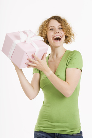 give out: Young Woman Holding Gift Box, Laughing, Portrait
