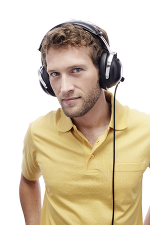 provoking: Young Man Wearing Headphones, Portrait, Close-Up LANG_EVOIMAGES