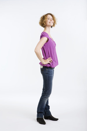 provoking: Young Woman Hand On Hip, Smiling, Portrait