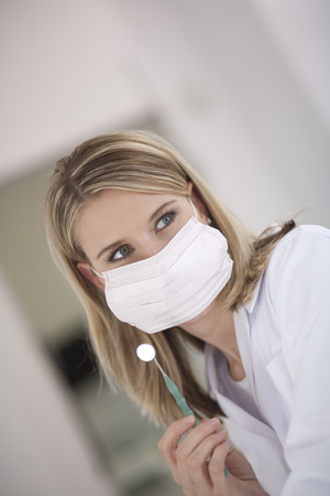 Germany, Bavaria, Landsberg, Female Dental Assistant Wearing Mask