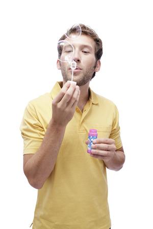 Young Man Blowing Soap Bubbles, Portrait