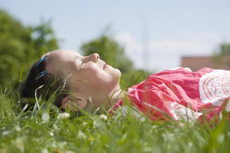 Little Girl (6-7) Sleeping In The Meadow