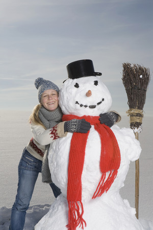 scarves: Germany, Bavaria, Munich, Woman Hugging Snowman